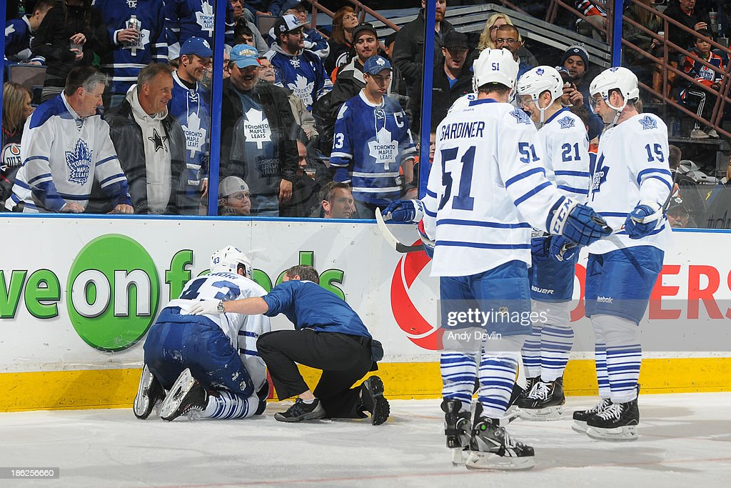 Team mates look on as Nazem Kadri #43 of the Toronto Maple Leafs is down and receiving medical attention in a game against the Edmonton Oilers on October 29, 2013 at Rexall Place in Edmonton, Alberta, Canada.