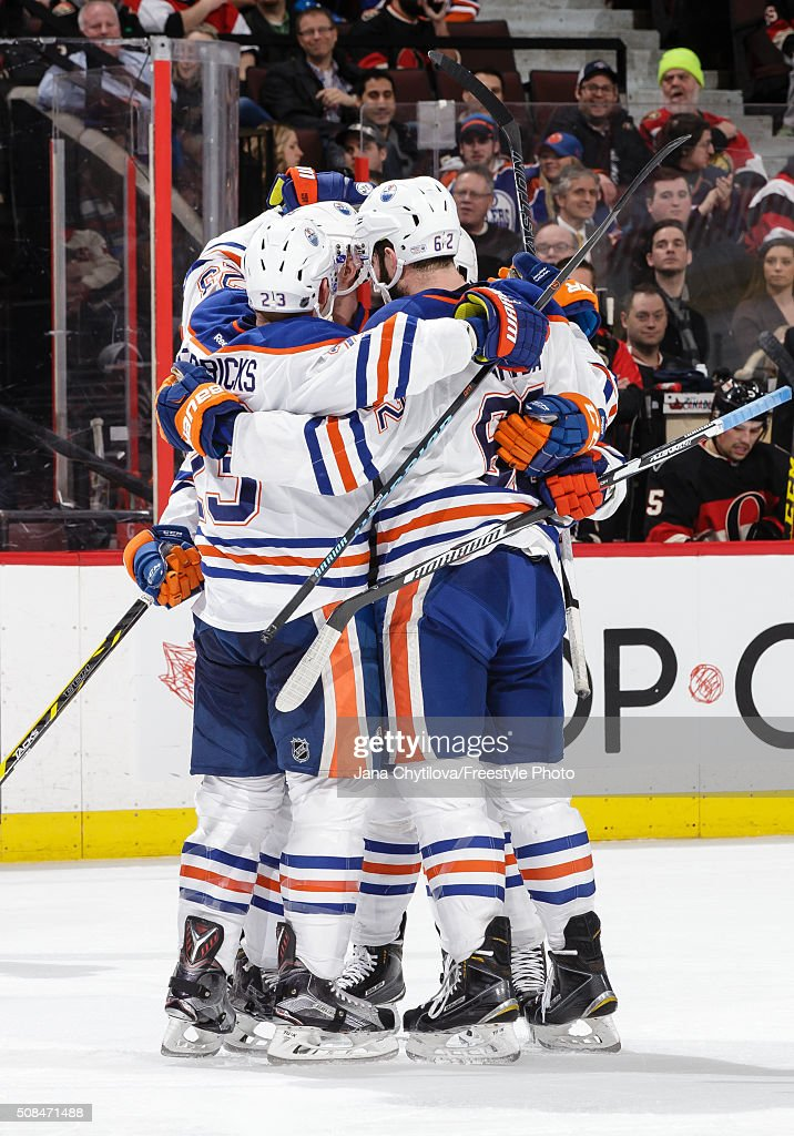 Team mates Matt Hendricks #23 and Eric Gryba #62 of the Edmonton Oilers celebrate a third period power-play goal and the seventh against the Ottawa Senators during an NHL game at Canadian Tire Centre on February 4, 2016 in Ottawa, Ontario, Canada.