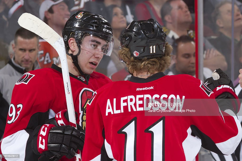 Team mates Mika Zibanejad #93 chats with Daniel Alfredsson #11 of the Ottawa Senators during an NHL game against the Buffalo Sabres at Scotiabank Place on February 12, 2013 in Ottawa, Ontario, Canada.