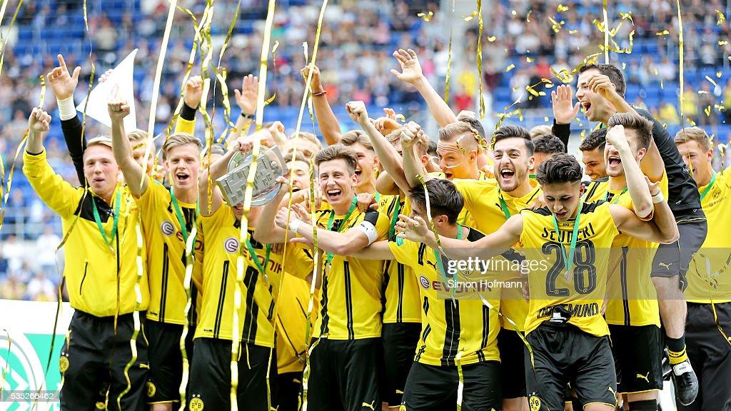 Team mates of Dortmund celebrate after the A Juniors German Championship Final match between 1899 Hoffenheim U19 and Borussia Dortmund U19 at Wirsol Rhein-Neckar-Arena on May 29, 2016 in Sinsheim, Germany.