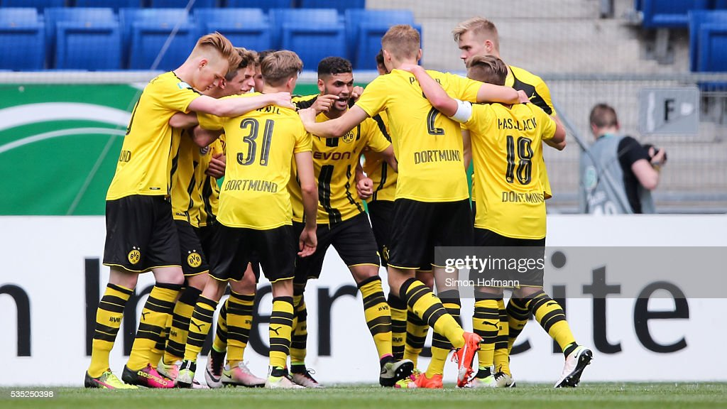 Team mates of Dortmund celebrate their fourth goal during the A Juniors German Championship Final match between 1899 Hoffenheim U19 and Borussia Dortmund U19 at Wirsol Rhein-Neckar-Arena on May 29, 2016 in Sinsheim, Germany.