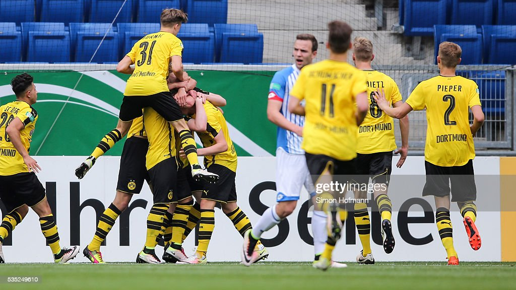 Team mates of Dortmund celebrate their third goal during the A Juniors German Championship Final match between 1899 Hoffenheim U19 and Borussia Dortmund U19 at Wirsol Rhein-Neckar-Arena on May 29, 2016 in Sinsheim, Germany.