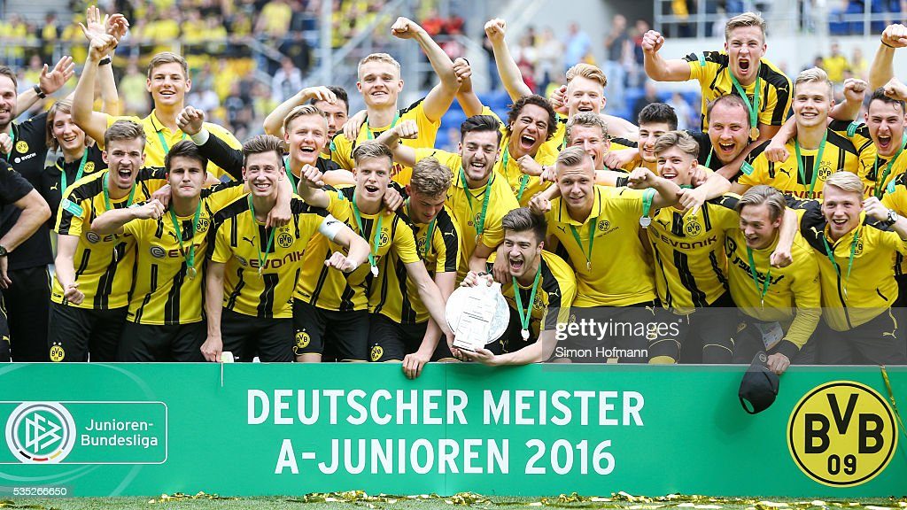 Team mates of Dortmund celebrate with the trophy after the A Juniors German Championship Final match between 1899 Hoffenheim U19 and Borussia Dortmund U19 at Wirsol Rhein-Neckar-Arena on May 29, 2016 in Sinsheim, Germany.