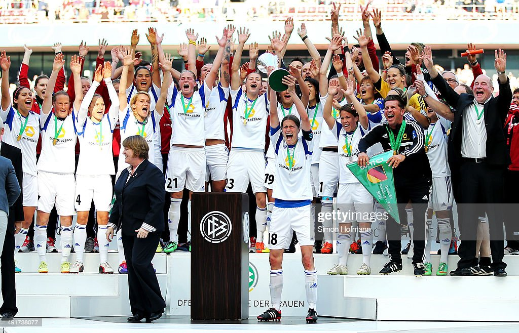 Team mates of Frankfurt celebrate winning with the trophy after the Women's DFB Cup Final between SGS Essen and 1. FFC Frankfurt at RheinEnergieStadion on May 17, 2014 in Cologne, Germany.