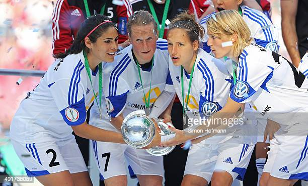 Team mates of Frankfurt celebrate winning with the trophy after the Women's DFB Cup Final between SGS Essen and 1 FFC Frankfurt at...