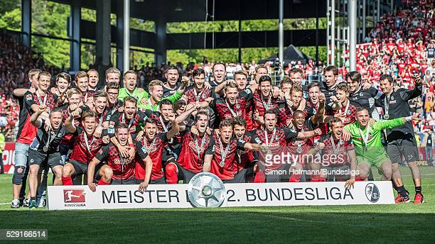 Team mates of Freiburg celebrate and pose for a team picture after the Second Bundesliga match between SC Freiburg and 1 FC Heidenheim at...
