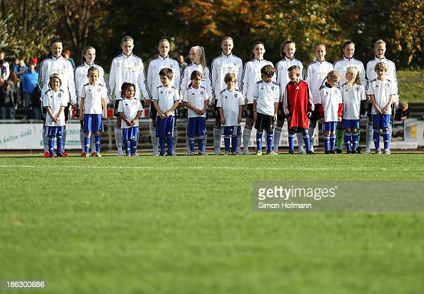 Team mates of Germany stand for their national anthem prior to the Girls U15 international friedly match between Germany and Scotland on October 30...