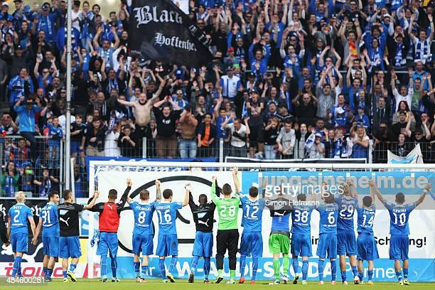 Team mates of Hoffenheim celebrate winning after the Bundesliga match between 1899 Hoffenheim and FC Augsburg at Wirsol RheinNeckar Arena on April 13...
