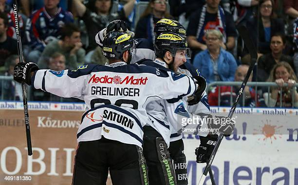 Team mates of Ingolstadt celebrate their first goal during the DEL Playoffs Final Game 1 between Adler Mannheim and ERC Ingolstadt at SAP Arena on...