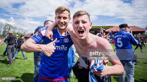Team mates of Kiel celebrate winning after the 3 Liga match between Sonnenhof Grossaspach and Holstein Kiel at Mechatronik Arena on May 13 2017 in...
