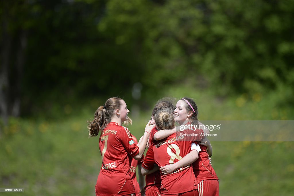 Team mates of Muenchen celebrate after scoring the third goal during the B Junior Girls match between Bayern Muenchen and VfL Sindelfingen at Sportpark Aschheim on May 4, 2013 in Aschheim, Germany.
