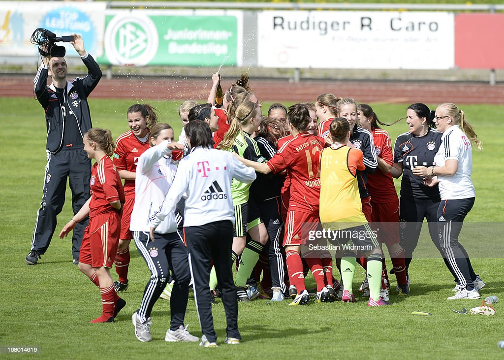 Team mates of Muenchen celebrate wining the match against Sindelfingen during the B Junior Girls match between Bayern Muenchen and VfL Sindelfingen at Sportpark Aschheim on May 4, 2013 in Aschheim, Germany.