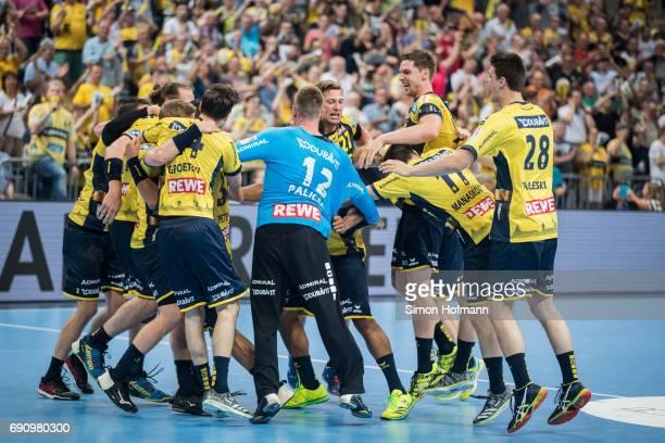Team mates of RheinNeckar Loewen celebrate victory after the DKB HBL match between RheinNeckar Loewen and THW Kiel at SAP Arena on May 31 2017 in...