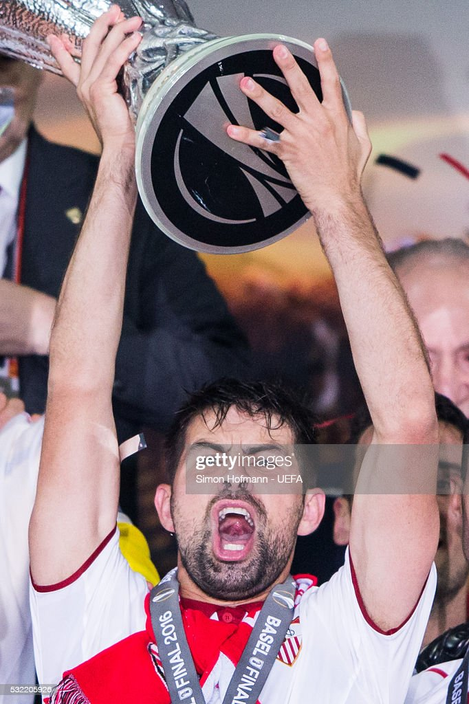 Team mates of Sevilla celebrate as Coke lifts the trophy after the UEFA Europa League Final between Liverpool and Sevilla at St. Jakob-Park on May 18, 2016 in Basel, Switzerland.