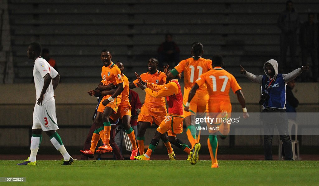 Team mates run to celebrate with Salomon Kalou of Ivory Coast after his last minute goal ensured victory during the FIFA 2014 World Cup Qualifier Play-off Second Leg between Senegal and Ivory Coast at Stade Mohammed V on November 16, 2013 in Casablanca, Morocco.