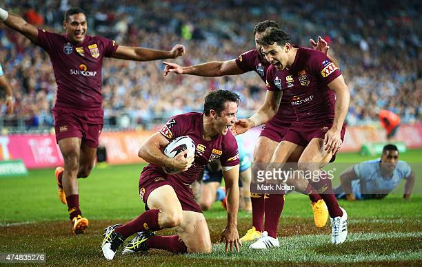 Team mates rush to congratulate Cooper Cronk of the Maroons after he scored a try during game one of the State of Origin series between the New South...