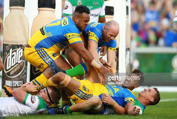 Team mates rush to congratulate Kaysa Pritchard of the Eels after he scored during the round five NRL match between the Canberra Raiders and the...