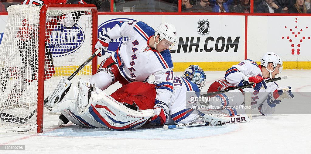 Team mates <a gi-track='captionPersonalityLinkClicked' href=/galleries/search?phrase=Ryan+McDonagh&family=editorial&specificpeople=4324983 ng-click='$event.stopPropagation()'>Ryan McDonagh</a> #27, <a gi-track='captionPersonalityLinkClicked' href=/galleries/search?phrase=Henrik+Lundqvist&family=editorial&specificpeople=217958 ng-click='$event.stopPropagation()'>Henrik Lundqvist</a> #30 and <a gi-track='captionPersonalityLinkClicked' href=/galleries/search?phrase=Anton+Stralman&family=editorial&specificpeople=2271901 ng-click='$event.stopPropagation()'>Anton Stralman</a> #6 of the New York Rangers lie on the ice after a scramble at the net, during an NHL game against the Ottawa Senators, at Scotiabank Place on February 21, 2013 in Ottawa, Ontario, Canada.