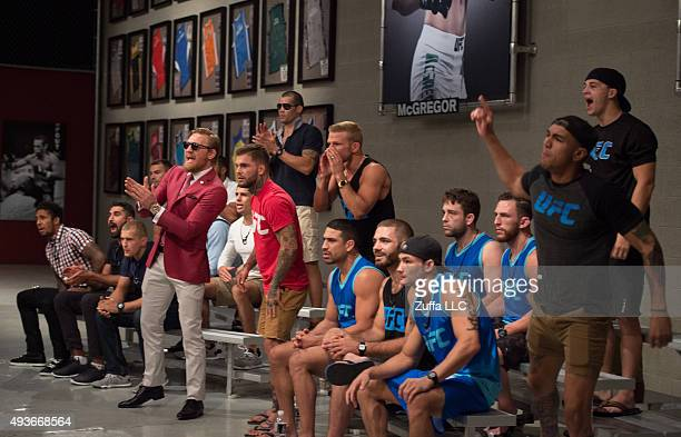 Team McGregor and Team Faber cheer as they watch Mehdi Baghdad face Julian Erosa during the filming of The Ultimate Fighter Team McGregor vs Team...