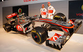 Team McLaren Mercedes drivers Lewis Hamilton and Jenson Button unveil the new MP27 Formula 1 car at the McLaren technology centre on February 1 2012...