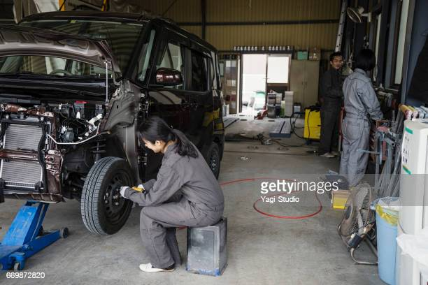 Team mechanics working together in an automotive repair shop