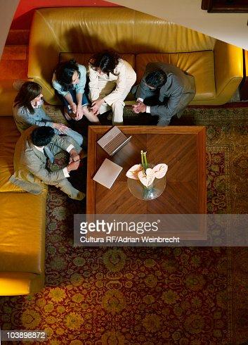 Team meeting in hotel lobby