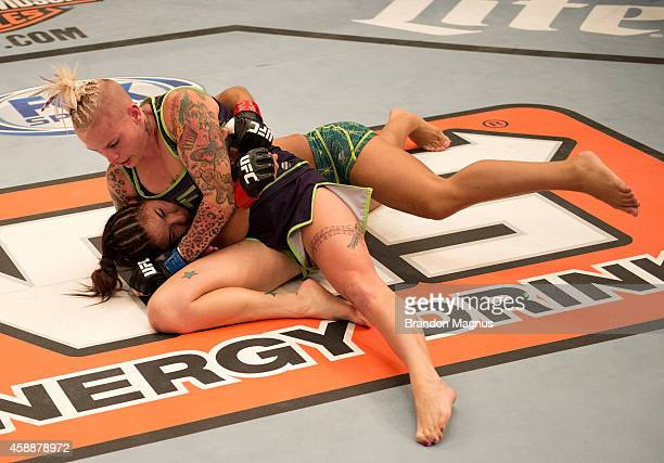 Team Melendez fighter Bec Rawlings controls the body of team Pettis fighter Tecia Torres during filming of season twenty of The Ultimate Fighter on...
