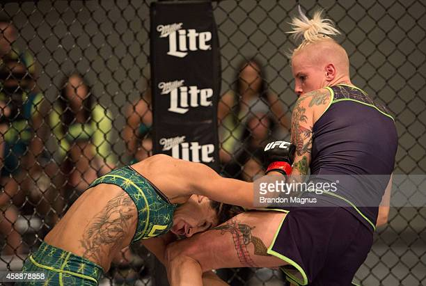 Team Melendez fighter Bec Rawlings knees team Pettis fighter Tecia Torres during filming of season twenty of The Ultimate Fighter on July 28 2014 in...