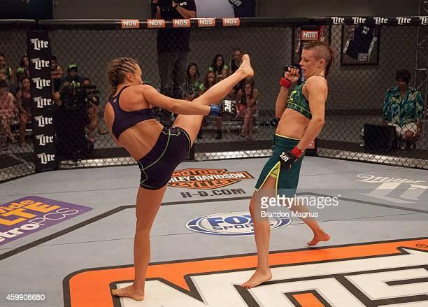 Team Melendez fighter Rose Namajunas kicks team Pettis fighter Joanne Calderwood in the quarterfinals during filming of season twenty of The Ultimate...