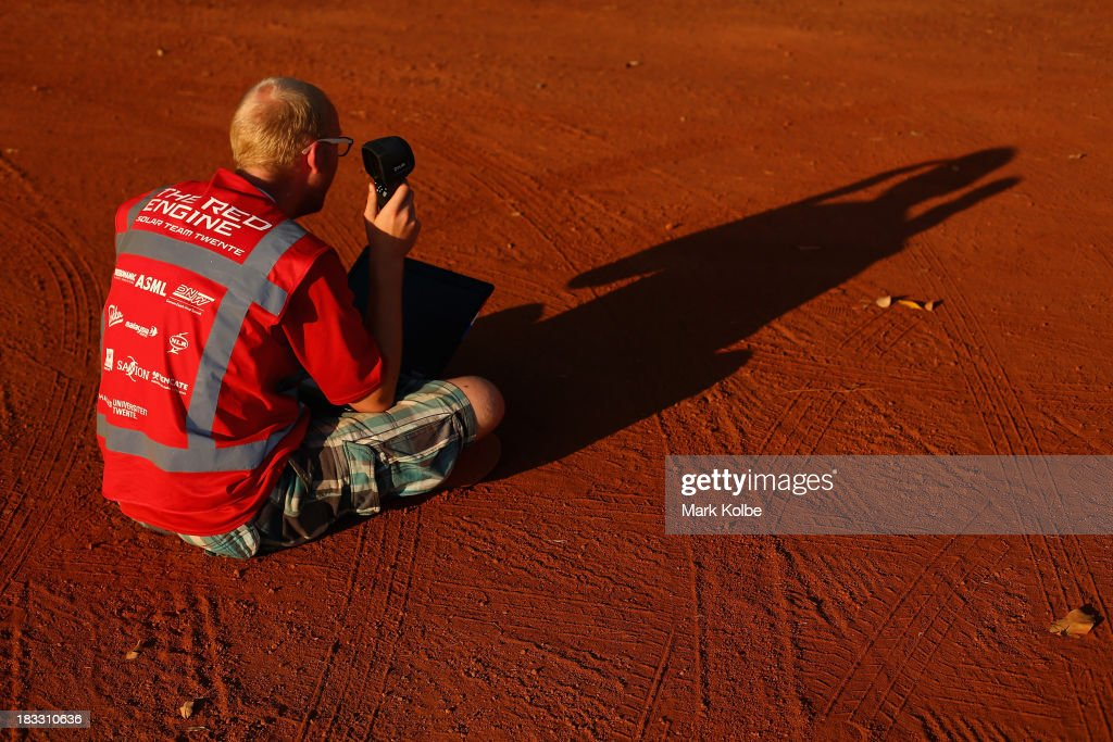A team member for RED Engine from the Solar Team Twente, University of Twente and Saxion in the Netherlands collect data as they catch the last of the sunlight ahead of their overnight stop at the end of racing in the Clipsal and Schneider Electric Challenger Class on Day 1 on October 6, 2013 in Elliott, Australia. Over 25 teams from across the globe will compete in the 2013 World Solar Challenge - a 3000 km solar-powered vehicle race between Darwin and Adelaide. The race begins today with the first car expected to cross the finish line on October 10th.