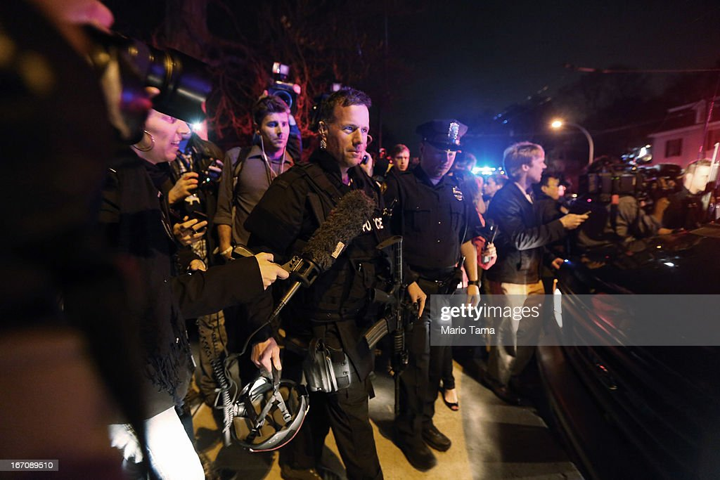 SWAT team member is followed by reporters and a celebrating crowd after the successful operation to capture 19yearold bombing suspect Dzhokhar A...