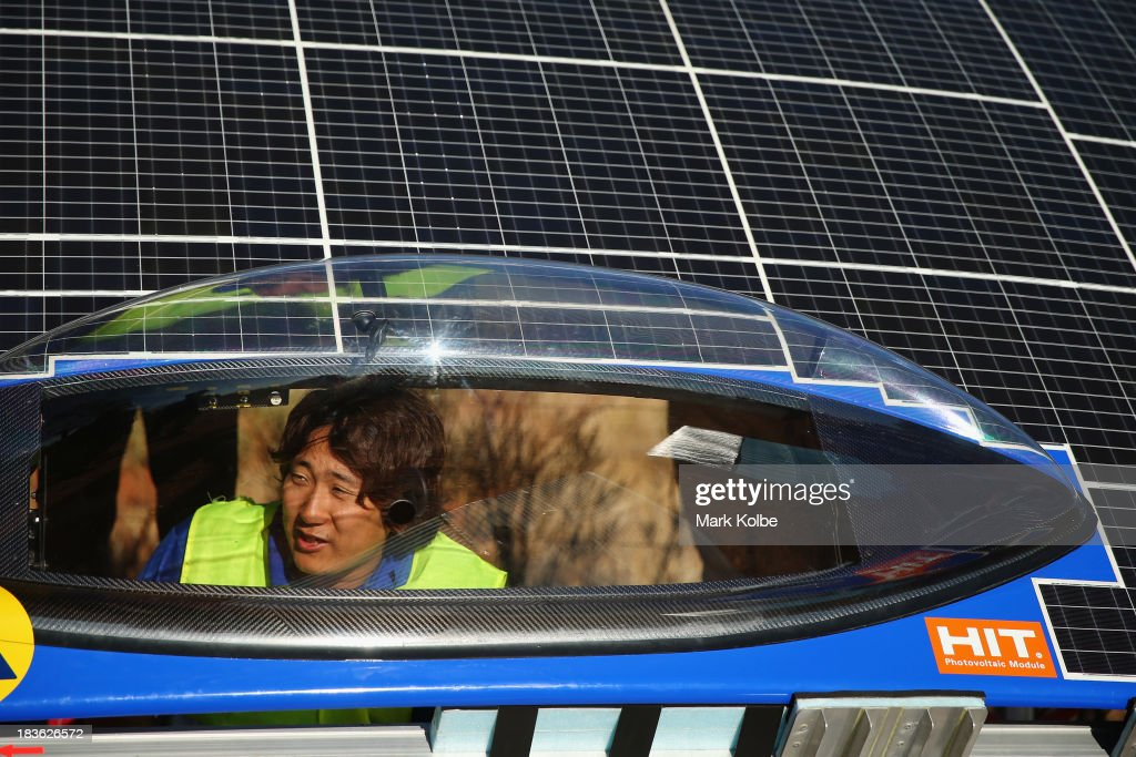 A team member looks out of the drivers window of Tokai Challenger from Tokai University in Japan as they prepare thier car to start racing on Day 3 on October 8, 2013 outside of Ti Tree, Australia. Over 25 teams from across the globe are competing in the 2013 World Solar Challenge - a 3000 km solar-powered vehicle race between Darwin and Adelaide. The race began on October 6th with the first car expected to cross the finish line on October 10th.