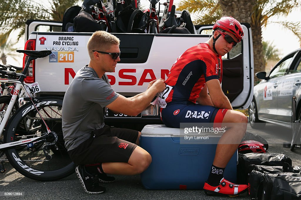A team member pins a race number on for Brenton Jones of Australia and Drapac Cycling at the start of stage one of the 2016 Tour of Qatar, a 176.5km road stage from Durkhan to Al Khor Corniche on February 8, 2016 in Durkhan, Qatar.
