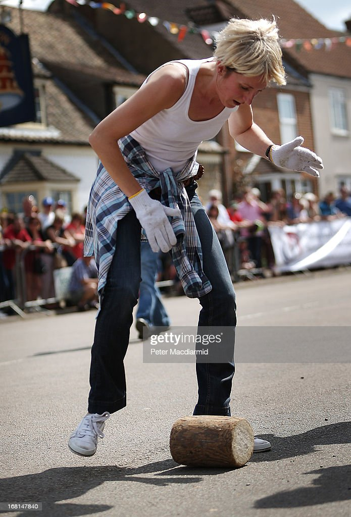 A team member rolls a wooden 'cheese' during the Stilton Village Festival cheese rolling competition on May 6, 2013 in Stilton, England. Local people are currently involved in a campaign to bring Stilton cheese making back to the village. The cheese is currently made in the counties of Nottinghamshire, Leicestershire and Derbyshire .