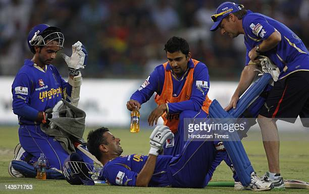 Team members attending the Rajasthan Royals batsman Rahul Dravid who lying on ground wincing in pain as he pulls a muscle ls during the IPL 5 T20...