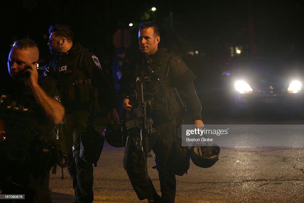 SWAT team members exit Franklin Street in Watertown with visible relief on their faces. After an intense manhunt and two-hour standoff in Watertown, law enforcement took a person into custody believed to be related to the Boston Marathon bombings.