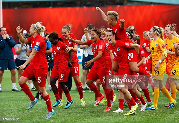 Team members from England react to their win over Germany during the FIFA Women's World Cup Canada 3rd Place Playoff match between England and...