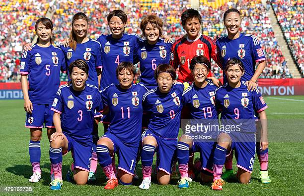 Team members from Japan pose for a team photo during the FIFA Women's World Cup Canada Semi Final match between England and Japan at Commonwealth...