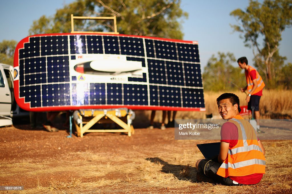 Team members from Luminos of the Stanford Solar Car Project, Stanford University in the United States of Americ collect data as they catch the last of the sunlight ahead of their overnight stop at the end of racing on Day 1 on October 6, 2013 in Elliott, Australia. Over 25 teams from across the globe will compete in the 2013 World Solar Challenge - a 3000 km solar-powered vehicle race between Darwin and Adelaide. The race begins today with the first car expected to cross the finish line on October 10th.