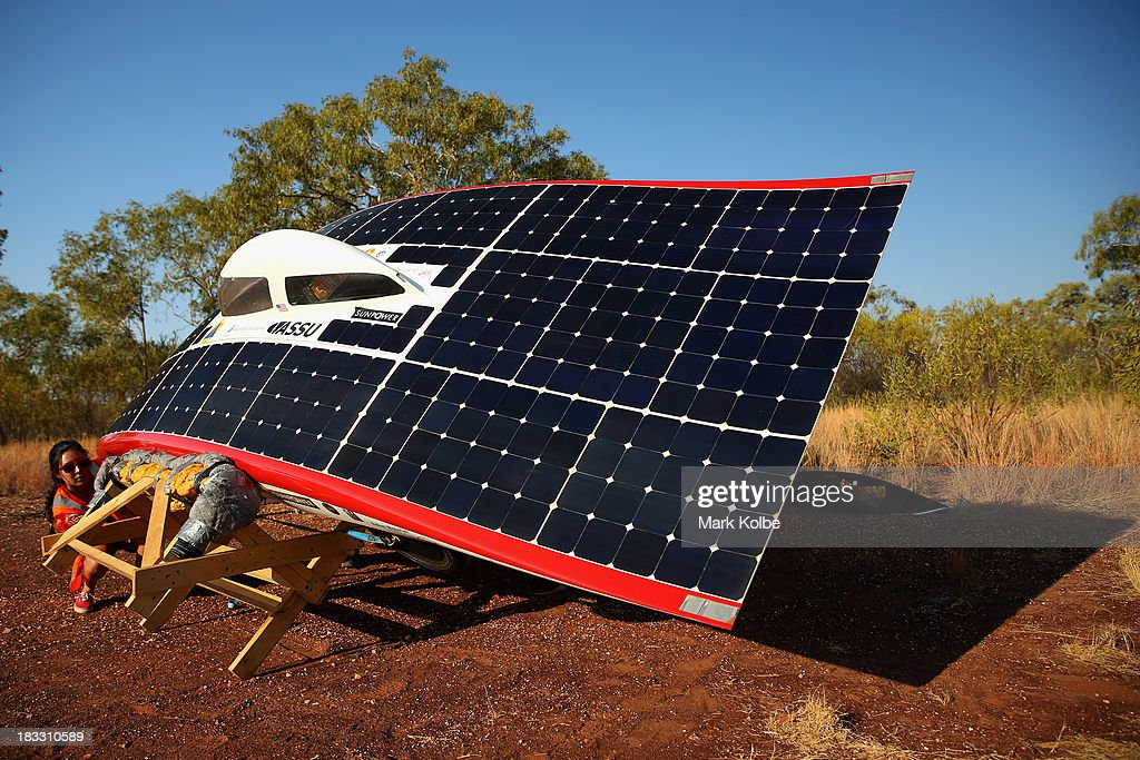 Team members from Luminos of the Stanford Solar Car Project, Stanford University in the United States of Americ catch the last of the sunlight ahead of their overnight stop at the end of racing on Day 1 on October 6, 2013 in Elliott, Australia. Over 25 teams from across the globe will compete in the 2013 World Solar Challenge - a 3000 km solar-powered vehicle race between Darwin and Adelaide. The race begins today with the first car expected to cross the finish line on October 10th.