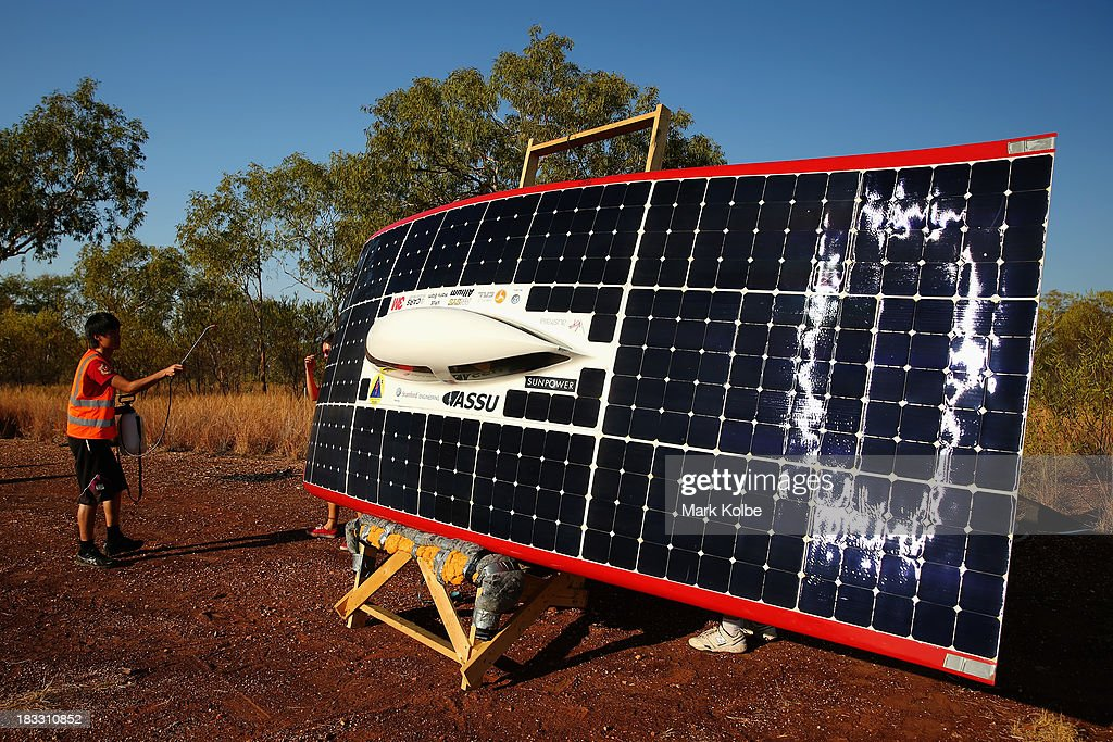 Team members from Luminos of the Stanford Solar Car Project, Stanford University in the United States of America sprays the panels as they catch the last of the sunlight ahead of their overnight stop at the end of racing on Day 1 on October 6, 2013 in Elliott, Australia. Over 25 teams from across the globe will compete in the 2013 World Solar Challenge - a 3000 km solar-powered vehicle race between Darwin and Adelaide. The race begins today with the first car expected to cross the finish line on October 10th.