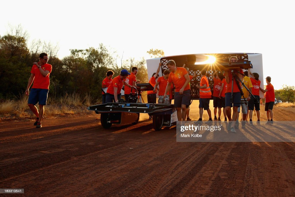 Team members from Nuna7 from Nuon Solar Team, Delft University of Technology, the Netherlands move their car to their campsite ahead of their overnight stop at the end of racing on Day 1 on October 6, 2013 in , Australia. Over 25 teams from across the globe will compete in the 2013 World Solar Challenge - a 3000 km solar-powered vehicle race between Darwin and Adelaide. The race begins today with the first car expected to cross the finish line on October 10th.