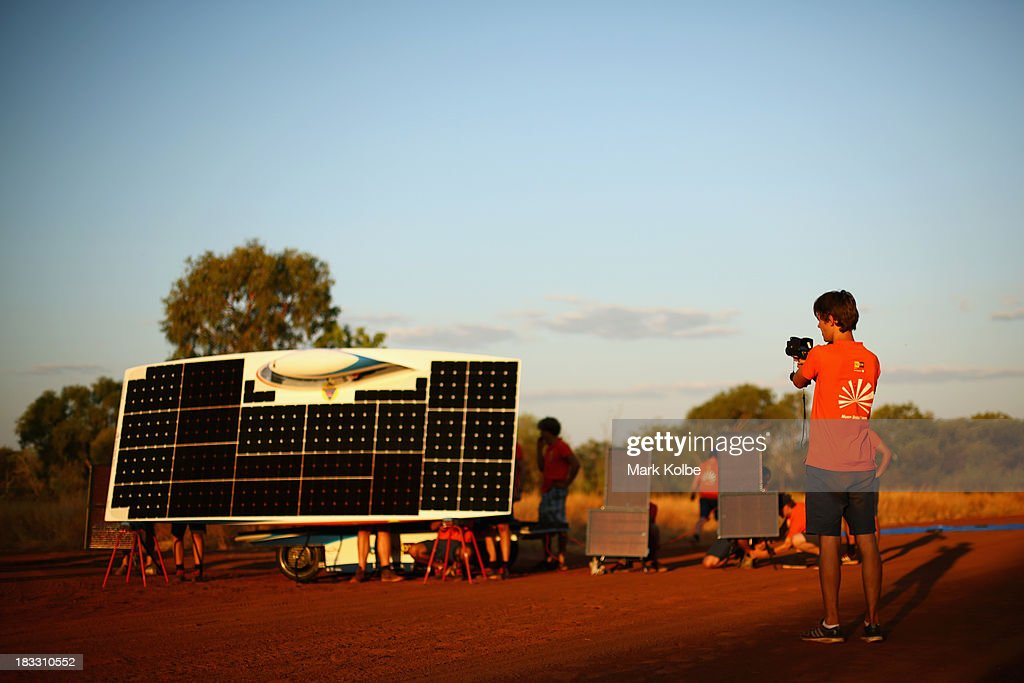 Team members from Nuna7 from Nuon Solar Team, Delft University of Technology, the Netherlands catch the last of the sunlight ahead of their overnight stop at the end of racing on Day 1 on October 6, 2013 in Elliott, Australia. Over 25 teams from across the globe will compete in the 2013 World Solar Challenge - a 3000 km solar-powered vehicle race between Darwin and Adelaide. The race begins today with the first car expected to cross the finish line on October 10th.