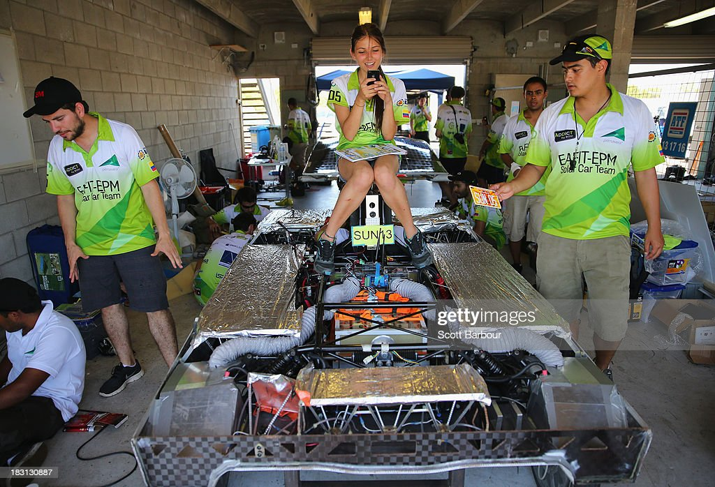 Team members from Primavera, from the EAFIT-EPM Solar Car Team, Universidad EAFIT Empress Publicas de Medellin, Colombia prepare to compete in the Clipsal and Schneider Electric Challenger Class during Dynamic Scrutineering in the Bridgestone World Solar Challenge at the Hidden Valley Motor Sports Complex on October 5, 2013 in Darwin, Australia. Over 25 teams from accross the globe will compete in the 2013 World Solar Challenge - a 3000 km solar-powered vehicle race between Darwin and Adelaide. The race begins on October 6th with the first car expected to cross the finish line on October 10th.