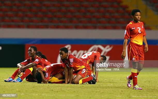 Team members Ghana look dejected after losing the penalty shot out during the FIFA U17 Women's World Cup 2014 quarter final match between Ghana and...
