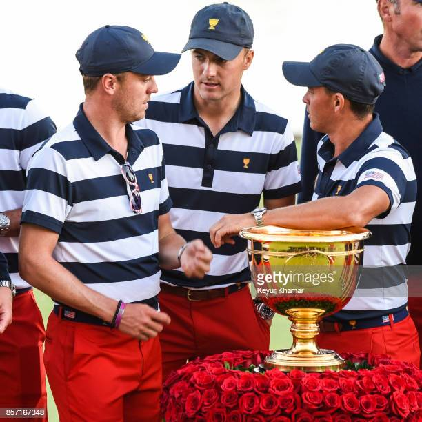 US Team members Justin Thomas Jordan Spieth and Rickie Fowler stand with the tournament trophy to celebrate their victory following Sunday Singles...