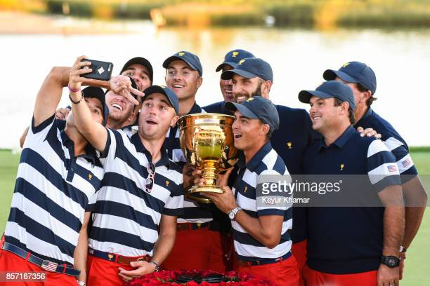US Team members Kevin Kisner Daniel Berger Brooks Koepka Justin Thomas Jordan Spieth Matt Kuchar Dustin Johnson Rickie Fowler Patrick Reed and Phil...
