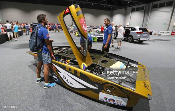 Team members look on as BOW ISTANBUL the car from Turkey's ITU Solar Car Team is tested during Static Scrutineering before competing in the...