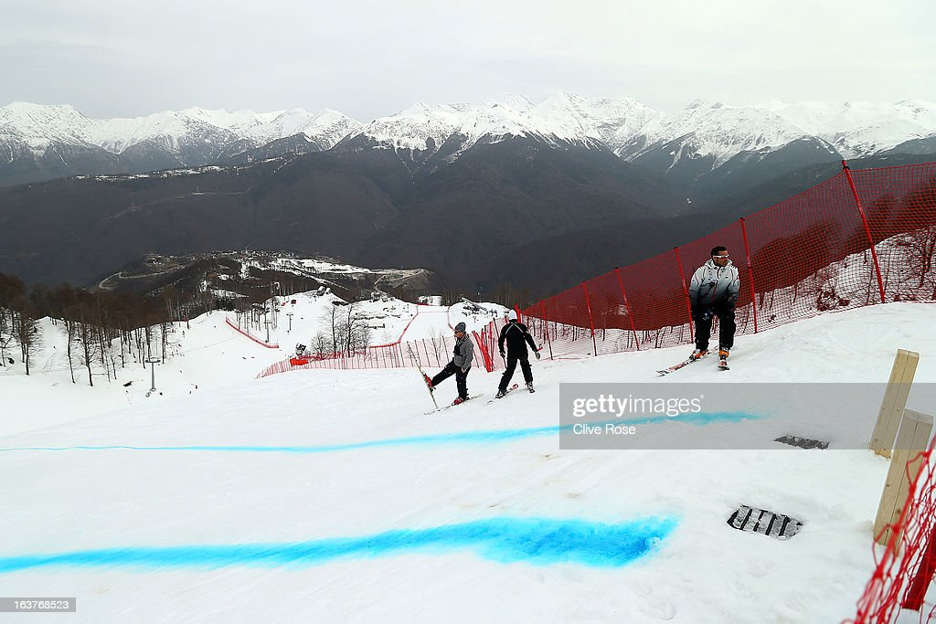 Team members look on from the start as bad weather postpones the women's Downhill Training at Rosa Khutor Alpine Center on March 15, 2013 in Sochi, Russia.