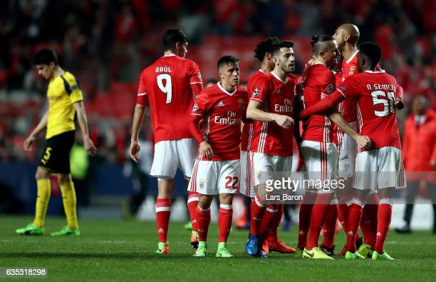 Team members of Benfica celebrate after the UEFA Champions League Round of 16 first leg match between SL Benfica and Borussia Dortmund at Estadio da...